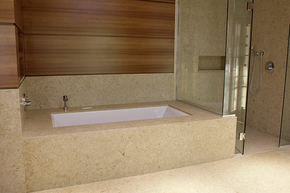 bathtub and shower by Stone Age Marble and Granite