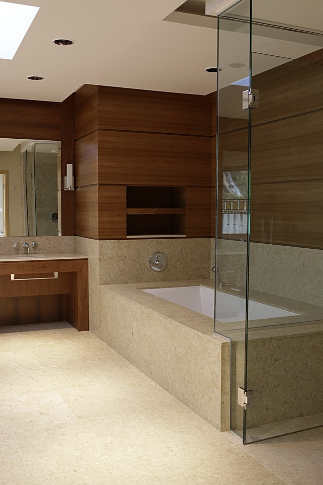 bathroom counter and bathtub by Stone Age Marble and Granite