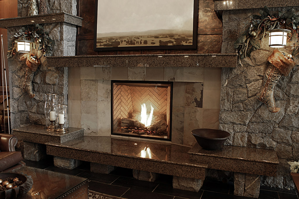 stone fireplace and mantle in home by Stone age Marble